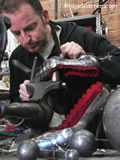 D 008 Nigel Carren making a pair of metal high heels for the catwalk