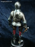 G 002 Miniature 16th century Greenwich style Armour for field and tournament showing four piece Cuirass and deep Greaves