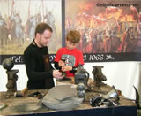 K 003 Teaching Bobby how to make an English Civil War helmet skull at Kelmarsh Festival of History