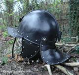 E 003 Nigel Carren lobster tail helmet side showing incised line detail